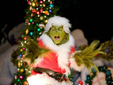 This undated photo courtesy of Universal Studios Hollywood shows a performance during the Grinchmas festivities at Universal Studios Hollywood in Universal City, Calif. From gingerbread exhibits to the Grinch to a new Louisville, Ky., attraction called KaLightoscope, destinations around the country are offering Christmas-themed attractions and fun. (AP Photo/Universal Studios Hollywood) NO SALES Travel Trip Christmas Attractions Travel_Trip_Christmas_Attractions_NYLS522.jpg